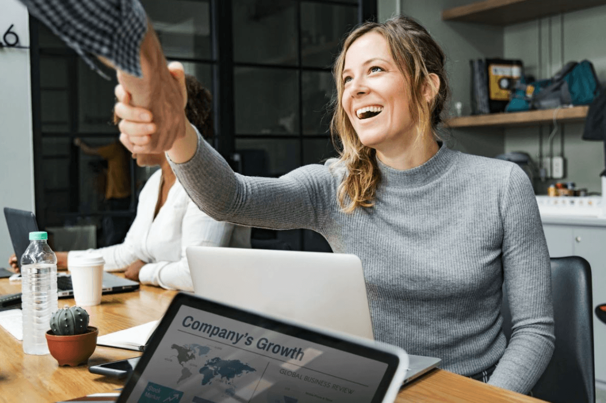 Woman shaking hands - content marketing